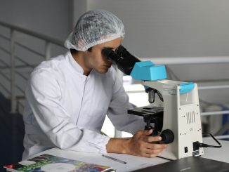 Technician using a microscope. How to protect intellectual property